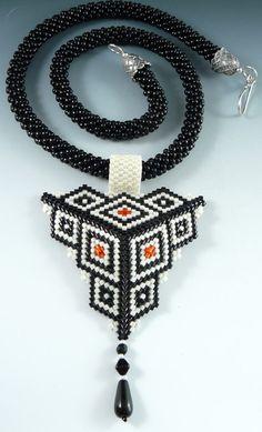Rona Loomis beaded focal on a bead crochet rope.