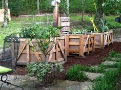 Patio garden using shipping crates from my business-also up cycled pallets, cardboard and styrofoam as filler inside.
