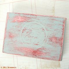 There are a few different ways of easily faking a distressed paint finish, and one of my favorites is to use a wax candle. Here's a tutorial I did for Deja Vue…