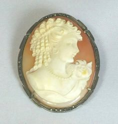 Check out this item in my Etsy shop https://www.etsy.com/listing/237502699/beautiful-victorian-carved-shell-cameo