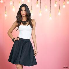 Look femenino. Falda negra, collar grande. #Moderna #sofisticada #cute
