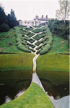 The Garden of Cosmic Speculation : a private estate in Scotland owned by an architect. The landscape designs include integrating fractals, a giant DNA helix and black holes. It's open to the public once a year. I wanna go!