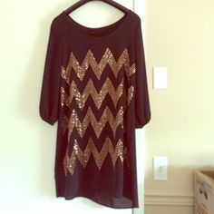 "Sparkly Gold Chevron Party Dress Worn only once (to my 21st birthday!) Great condition. Hits mid thigh (I'm 5'4""). Soft and silky material. Gold jeweled chevron pattern on front only! Cuffed sleeves (quarter sleeves) Dresses Midi"