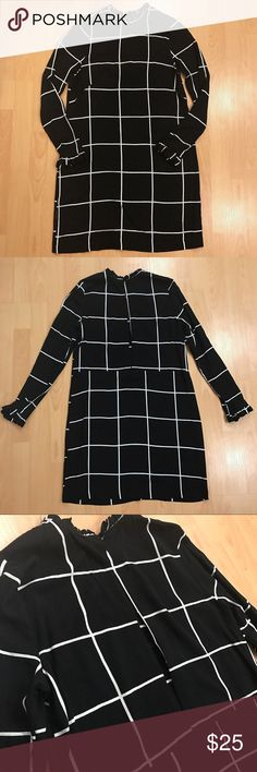 H&M Black and White Plaid Shift Dress Black and white plaid shift dress from H&M with a high neck, long sleeves, and ruffle details at collar and wrists. The back has long open slit down the spine. Looks very chic! Never worn!! H&M Dresses Long Sleeve