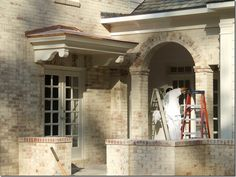 Beauty of the limewash detail can be seen quite clearly here. I love how they varied the effect on the brick arch and on the tops of the brick walls.  Product: San Marco lime wash paint was used on the exterior.   go to the website for San Marco,http://www.san-marcousa.com/, which offers a full range of interior and exterior mineral based paints.