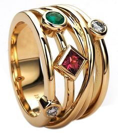Yellow gold ring featuring a mix of gemstones. Gemstones are personalized to reflect your family's birthstones.