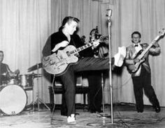 Eddie Cochran and the Kelly Four a.k.a. The Hollywood Swingers in Chadron, Nebraska, October 3, 1959. Left to right: Gene Riggio, drums; Eddie Cochran, guitar; Mike Deasy, baritone saxophone (hidden behind Eddie); Mike Henderson, tenor saxophone; and Dave Shriver, bass.