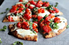 A Roasted Tomato Caprese Flatbread topped with a sweet Balsamic Reduction. The flatbread recipe will be your new all time favorite Caprese recipe.