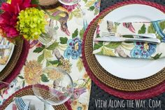 Place setting with multicolored runner and flowers on an outdoor table at View Along the Way