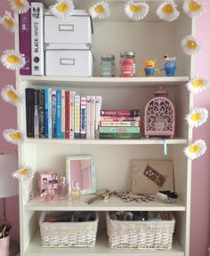 Use a bookcase to store everything in baskets and boxes