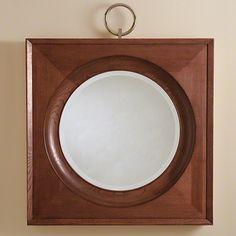 Espejo redondo en roble ,cuelga en un anillo niquelado con cobre amarillo.