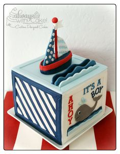 nautical cake...block with something different on each side (anchor, whale, wheel, boat)