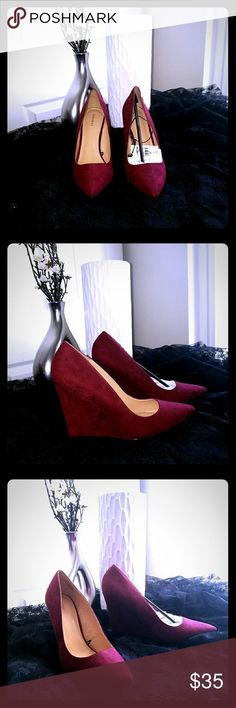"""NWT EXPRESS 4"""" Suede Burgundy Red Wedge Shoes NWT EXPRESS 4"""" Suede Burgundy Red Wedge Shoes. Never worn. Great Condition. May have some natural shadows from handling suede material.   Smoke Free & Pet Free Home Express Shoes Wedges"""