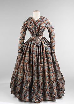 Printed wool and silk dress, American, ca. 1843. This is a stunning example of the beauty of printed and dyed fabrics that were used in the 1840s. The combination of design complexity with complicated printing and ombré dying methods create this visually satisfying textile which is shown to full effect on the full skirts of the period.