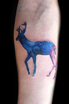 ink splatter deer tattoo, love the effect