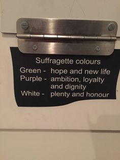 Suffragette colors... purple should really be violet. together it stands for give women the vote.