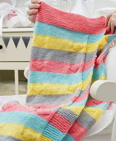 Free Knitting Pattern for Easy Love You Knit Baby Blanket - Heart motifs embellish this colorful striped baby blanket. Designed by Melody Rogers for Red Heart.