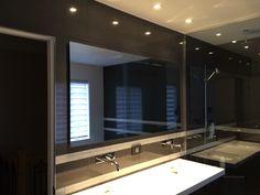 Large frameless bathroom mirror