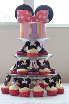 """This cake was designed to go with the baby Minnie first birthday party ware.  6"""" smash cake and 30 cupcakes matching the theme."""