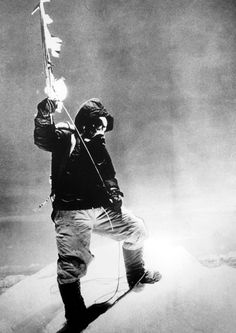 Sherpa Tenzing Norgay stands on the summit of Mount Everest