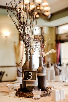 Rustic country wedding stunning and delightful decoration ideas. Wine Bottle Vases, Wine Bottle Centerpieces, Wedding Wine Bottles, Wedding Table Centerpieces, Wine Bottle Crafts, Wedding Decorations, Centerpiece Ideas, Bottle Art, Diy Wedding