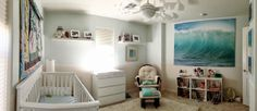 Not crazy about all the white and neutral colors but I think it's cool to have a big picture of the ocean on the wall like that.