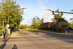 """Fifth Street, the """"Avenue of the Architects,"""" in Columbus, Indiana, looking west toward Mill Race Park and Eos sculpture, 