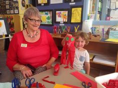 Rhona Day Kindergarten head teacher Bev O'Connor helps Rupert Vincent make a lantern. The Temuka kindy celebrated Chinese New Years this morning.