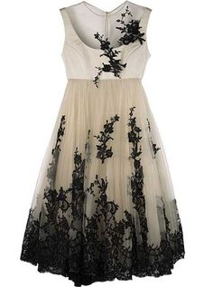 cream baby doll dress with black lace applique embellishments and sheer top, ethereal pleats
