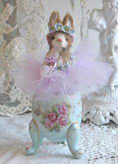 Lavender Easter bunny sitting on shabby roses ceramic egg