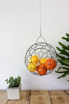 Medium sphere fruit/veggie basket. This would be great to hang under wall cabinets in kitchen if you don't have much counter space.