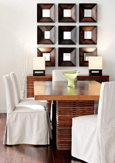 mirror wall by dining table