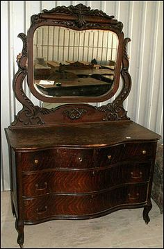 Tiger Oak Vanity with Mirror I wish the one I have looks like this one. The mirror & its base is missing. Mine is of oak & has the curved drawers. I got it for free lucky me