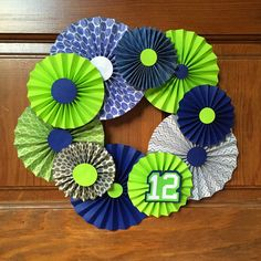 Sowdering About: Seahawks Rosette Wreath… Wreath Crafts, Diy Wreath, Diy And Crafts, Paper Crafts, Paper Rosettes, Types Of Craft, Craft Projects, Craft Ideas, Seattle Seahawks