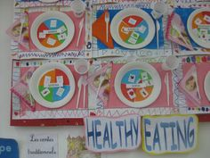 We made these place settings in my 4-5 year old class the children had the four main food groups on the plate, all colour coded they drew their own food, The cup contains water. They decorated their placemats, and set the place setting (properly) They were very enthusiastic about this activity. Made a nice display board