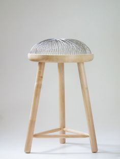 """""""Dome"""" by Toer - eighty curved steel rods spring out of the wooden base create a polar array, thus creating the appearance of sitting on air!"""