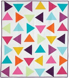 I am so excited to finally be able to share with you my Triangle Toss Quilt in McCall's Quilting May/June 2012 issue.  I thoroughly love this quilt. =)  Don't be intimidated by all of t…