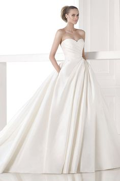 Simple elegant strapless ball gown wedding dress by Atelier Pronovias, 2015