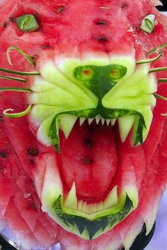 Amazing watermelon carving.  I love how the artist left the rind for the nose and mouth.