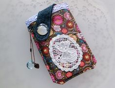 Show your style and have some fun with this beautifully 90% hand-stitched and 10% machine embroidery pouch to protect your cell phone or favorite g...