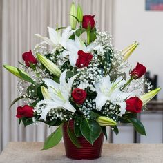 """Center """"Elegant"""" red and white, beautiful composition of red roses and liliums A … – Modern Valentine Flower Arrangements, Basket Flower Arrangements, Creative Flower Arrangements, Altar Flowers, Funeral Flower Arrangements, Church Flowers, Beautiful Flower Arrangements, Silk Flower Arrangements, Flower Centerpieces"""