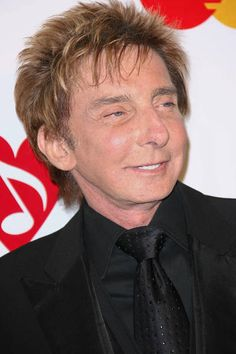 Barry Manilow attending 2011 MusiCares Person of the Year Tribute to  Barbra Streisand.
