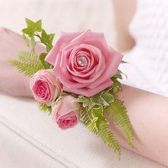 Pretty pink rose corsage.