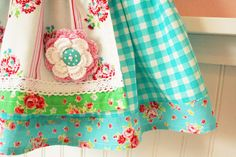 apron with crochet flower