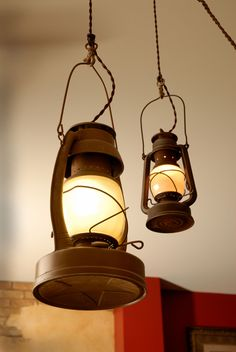 Love these lamps (old oil lamps). Especially the clip hook detail on the top.