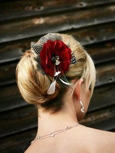 Loose bun, fastened  with a flower hairpin.