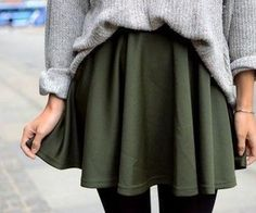 Green skirt and grey sweater.