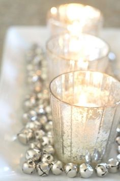Opulent Christmas Inspiration | Cox & Cox - tealights in frosted holders on a platter surrounded by small metal ball bearings, bells, or miniature baubles #centrepiece #decor...x