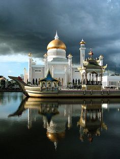 Mosque is named Sultan Omar Ali Saifuddin III. It is a royal Islamic mosque, in Bandar Seri Begawan, which is the capital of the sultanate of Brunei. The ceremonial barge is in the foreground. (V)