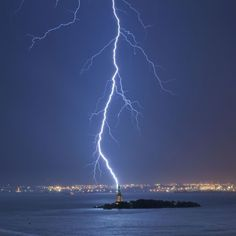 Photo Credit: Jay Fine / Caters News. Lightning strikes near the Statue of Liberty in New York City, Oct. 11, 2010.
